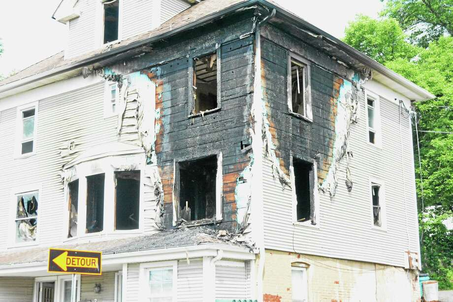 The second- and third-floor apartments sustained the most damage at 3 North Main St., Terryville. The fire is believed to have started in the third-floor bedroom. Photo: Jenny Golfin — The Register Citizen