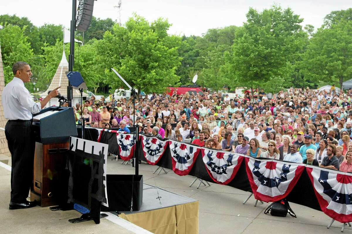 """In this June 27, 2014, file photo, President Barack Obama speaks about the economy at Lake Harriet Band Shell in Minneapolis, Minn. """"It's easy to be cynical. In fact, these days itís kind of trendy,"""" Obama told a crowd of thousands in Minneapolis."""