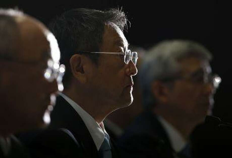 Toyota Motor Corp President Akio Toyoda (C) attends a news conference with executive vice presidents in Nagoya, central Japan July 1, 2013. Toyota Motor Corp executives have sometimes seemed to share the personality of the automaker's best-selling cars - dependable and efficient, but also a bit boring and bland. That's changing. In recent months, Toyota founding family scion and President Akio Toyoda has emerged from the bureaucratic shadows to present himself as the company's car-loving, fashion-forward salesman-in-chief. REUTERS/Toru Hanai (JAPAN - Tags: TRANSPORT BUSINESS) Photo: REUTERS / X90040