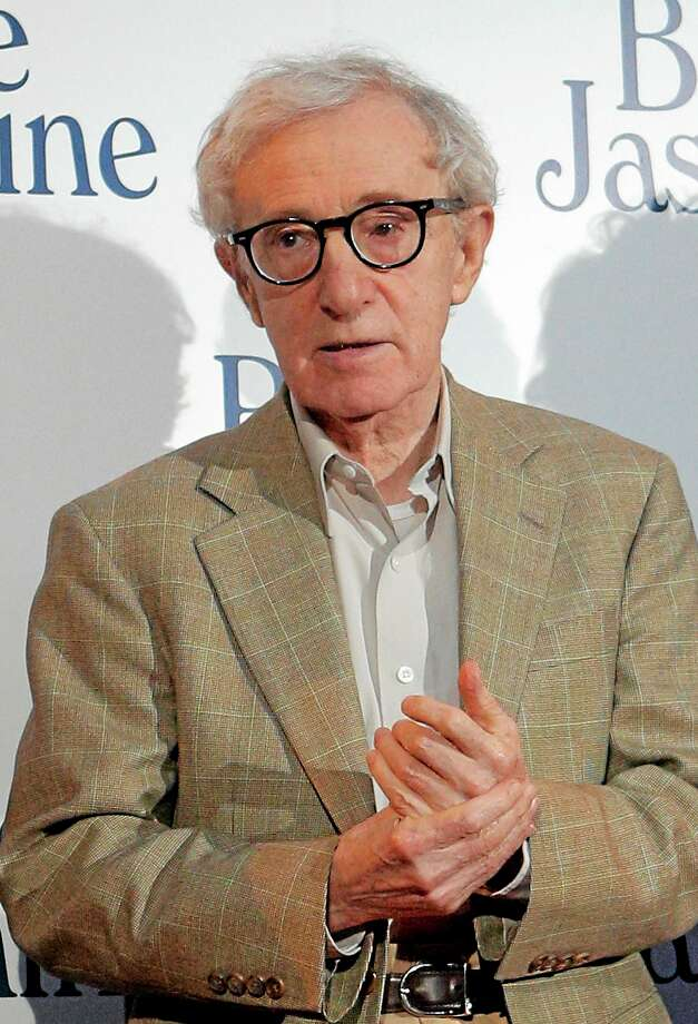 """This Aug. 27, 2013 file photo shows director and actor Woody Allen at the French premiere of """"Blue Jasmine,"""" in Paris. In an Op-Ed piece by Nicholas Kristof published on the New York Times website on Saturday, Feb. 1, 2014, the author referenced a letter by Allenís adopted daughter Dylan Farrow, 28, that he posted on his blog, detailing how she was molested by Allen while growing up.  AP Photo/Christophe Ena Photo: AP / AP"""