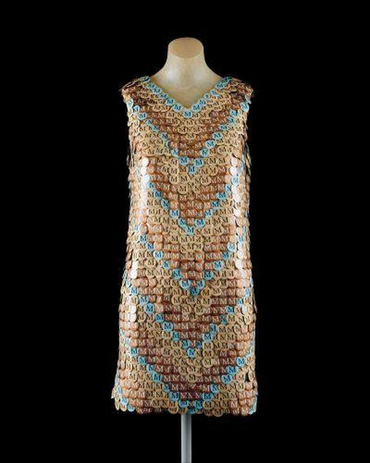 """This undated photograph provided by the Metropolitan Museum of Art shows """"Dress"""", made of the museum's admission buttons by Ji Eon Kang, a gift to the museum by Richard Martin. Starting Monday, June 30, 2013, the button will be replaced with a paper ticket with detachable sticker. Museum officials say it has become too expensive to produce the buttons. They were introduced in 1971. The buttons came in 16 different colors and featured the letter """"M."""" The color was changed daily. The change comes around the time the Met is switching to a seven-day week. It has been closed Mondays. (AP Photo/Metropolitan Museum of Art) Photo: AP / Metropolitan Museum of Art"""