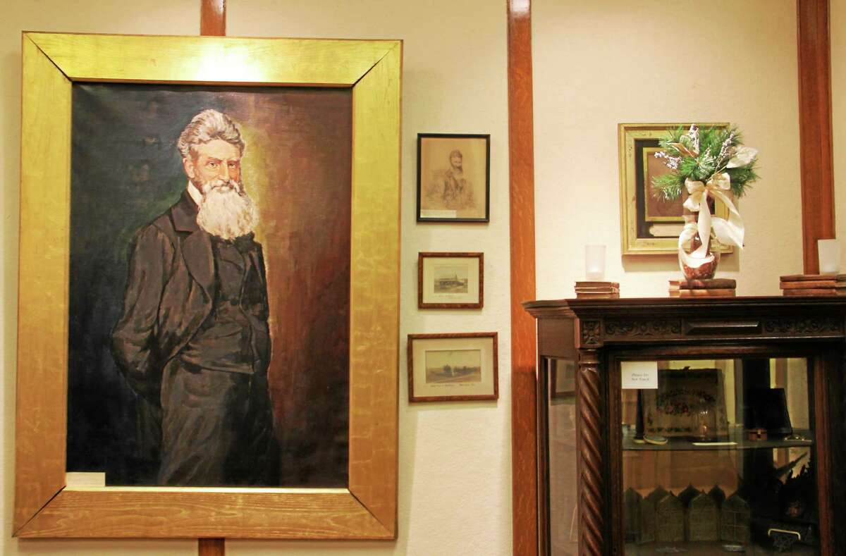 A portrait of Torrington's most infamous son, John Brown, hangs inside the museum and program room of the Torrington Library on Friday, Jan. 31, 2014.