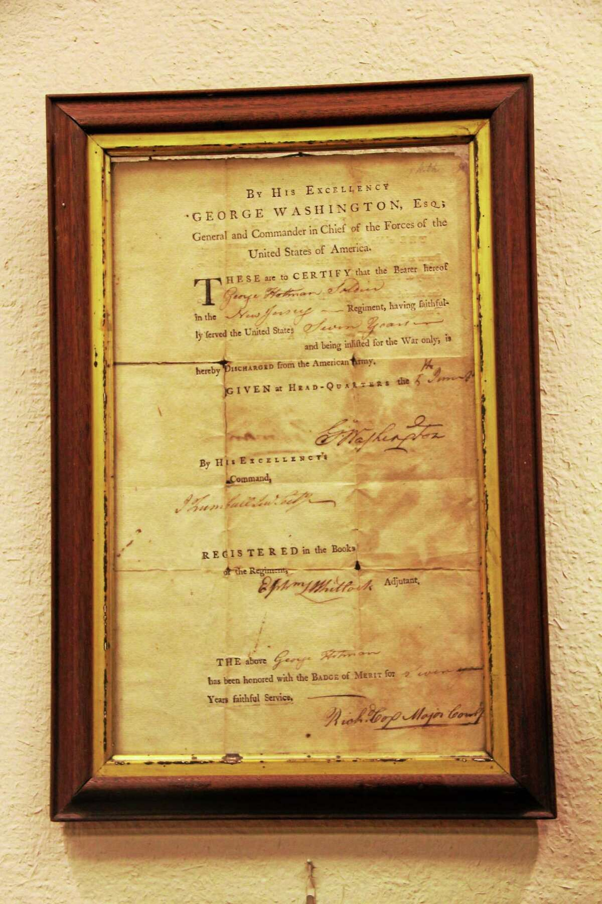 The Army discharge letter signed by George Washington, which hangs in the museum and program room of the Torrington Library, on Friday, Jan. 31, 2014. The piece is one of the most historically significant artifacts housed by the library.