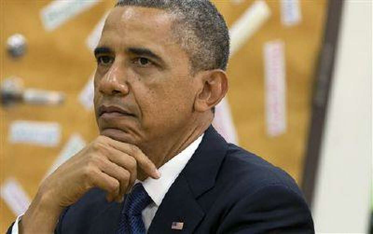 """President Barack Obama views a math project during a tour of Mooresville Middle School in Mooresville, N.C., Thursday, June 6, 2013. The president traveled to Mooresville, N.C. to promote his """"Middle Class Jobs and Opportunity Tour."""" (AP Photo/Evan Vucci)"""