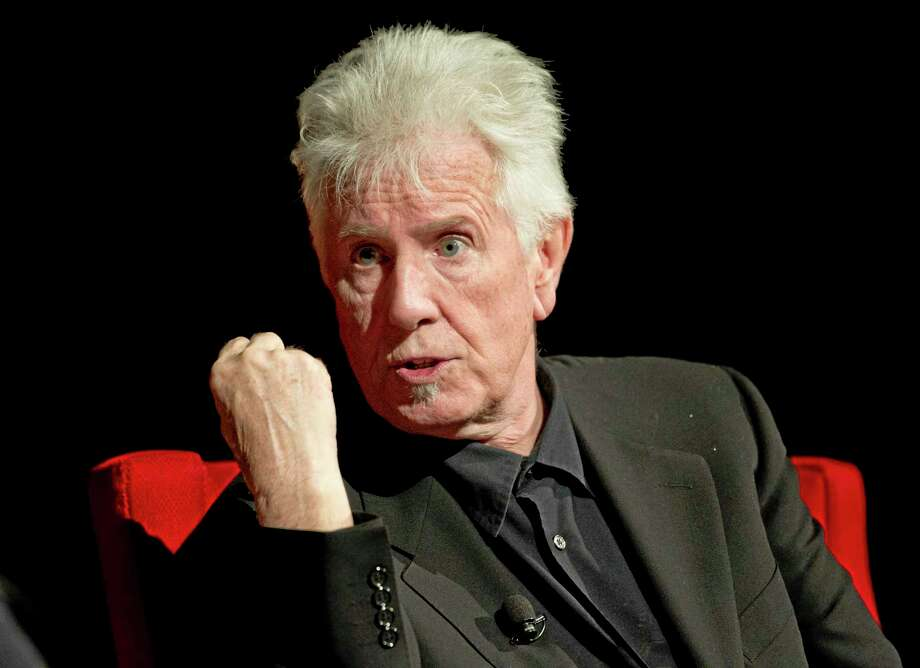 FILE - In this April 8, 2014 file photo, Rock and Roll Hall of Fame singer-songwriter Graham Nash speaks during the Civil Rights Summit at the Lyndon B. Johnson Presidential Library,  in Austin, Texas. The 72-year-old member of Crosby, Stills and Nash spoke exclusively to The Associated Press on Monday, July 7, 2014, after the Paley Center for Media hosted a discussion with the trio regarding their newly released remastered box set commemorating their 1974 tour with Neil Young. (AP Photo/Statesman.com, Jay Janner, Pool, File) Photo: AP / Pool Austin American-Statesman