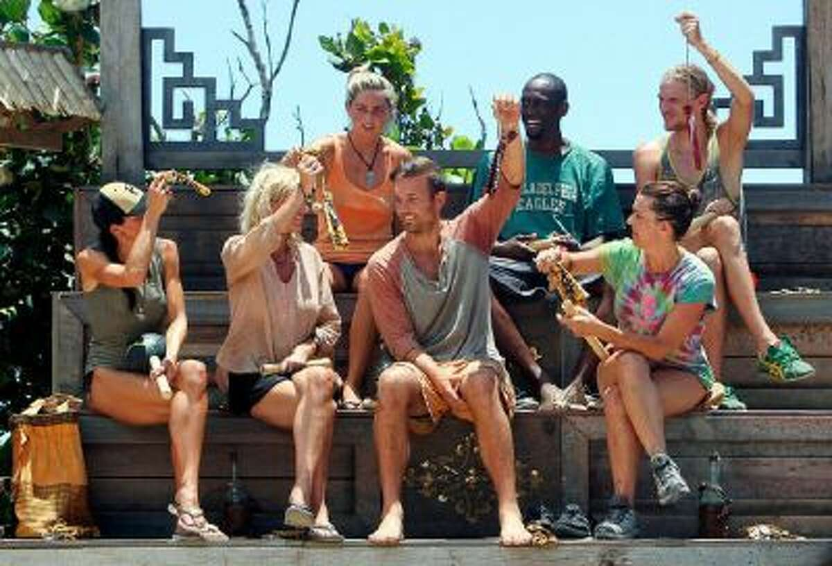 The Galang Tribe hold up their new buffs during the sixth episode of SURVIVOR: BLOOD vs. WATER, Wednesday, Oct. 23 (8:00-9:00 PM, ET/PT) on the CBS Television Network.