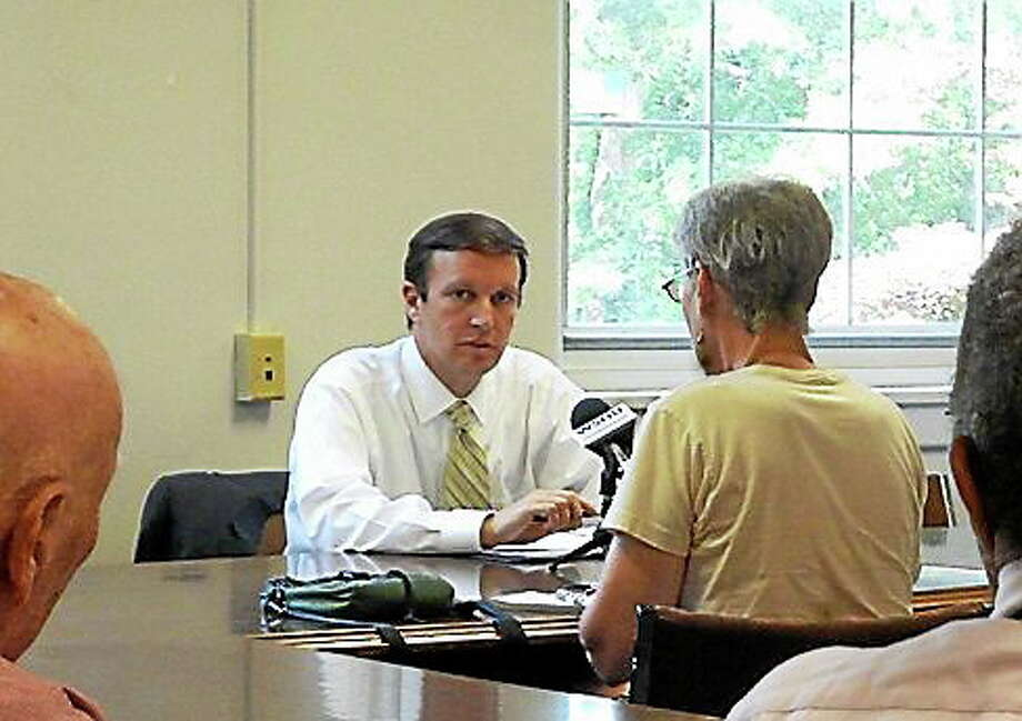 Sen. Chris Murphy listens to environmental advocates. Photo: Jhansi Katechia, CT News Junkies