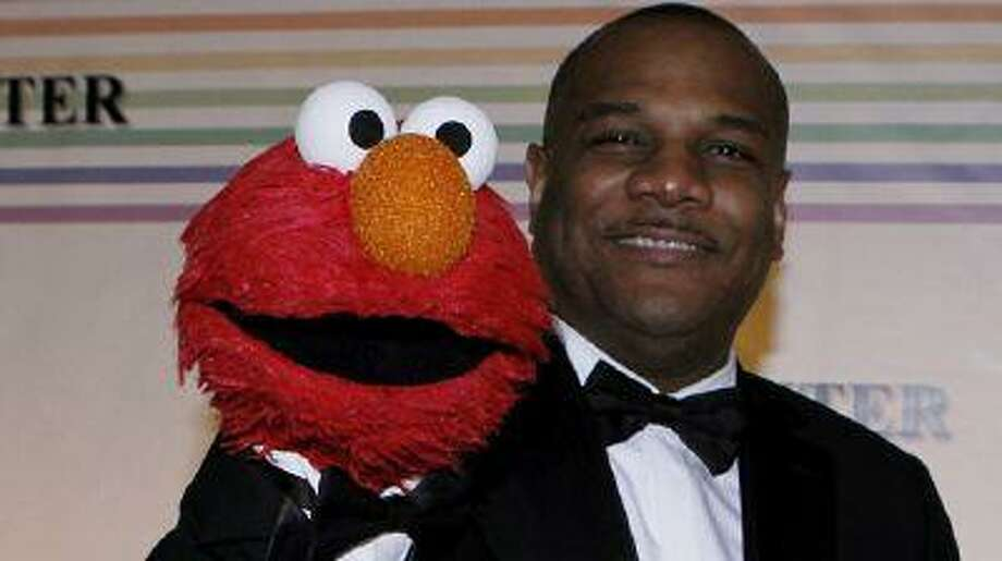 Kevin Clash (right) and Elmo. (REUTERS)