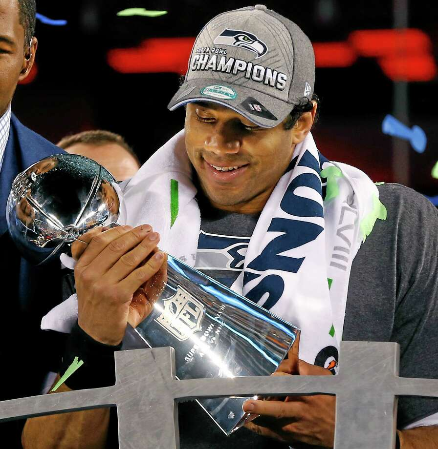 Seattle Seahawks quarterback Russell Wilson holds the Lombardi Trophy after the NFL Super Bowl XLVIII football game Sunday, Feb. 2, 2014, in East Rutherford, N.J. The Seahawks won 43-8. (AP Photo/Paul Sancya) Photo: AP / AP