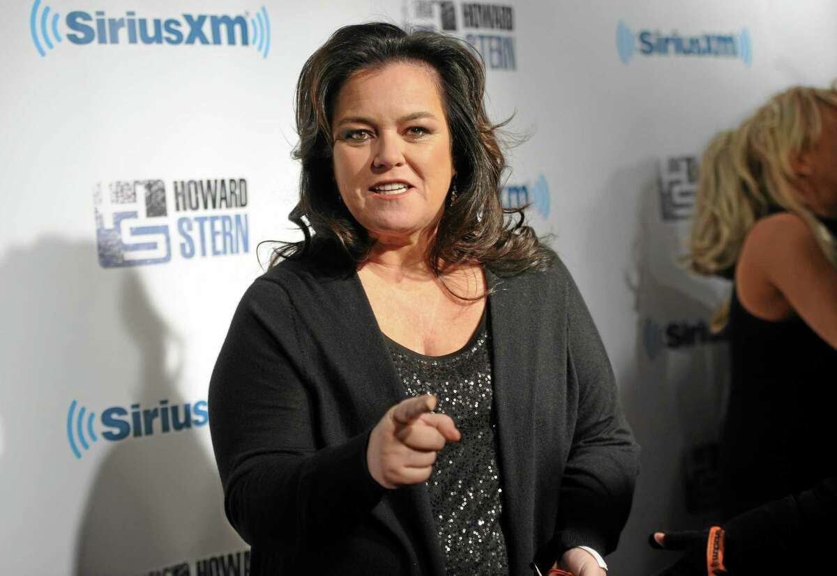 """FILE - This Jan. 31, 2014 file photo shows television personality Rosie O'Donnell attends """"Howard Stern's Birthday Bash,"""" presented by SiriusXM, at the Hammerstein Ballroom in New York. The Tony Awardís administration committee said Tuesday, April 1, that O'Donnell host will get the 2014 Isabelle Stevenson Award, given to a member of the theater community for philanthropic efforts. (Photo by Evan Agostini/Invision/AP, File)"""