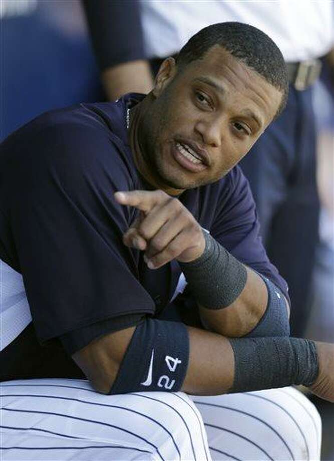 FILE -  In this March 28, 2013, file phot, New York Yankees Robinson Cano sits in the dugout during a spring training baseball game at Steinbrenner Field in Tampa, Fla. Cano plans to switch agents from Scott Boras to a new company formed by musician Jay-Z's Roc Nation and CAA Sports. (AP Photo/Kathy Willens, File) Photo: ASSOCIATED PRESS / AP2013