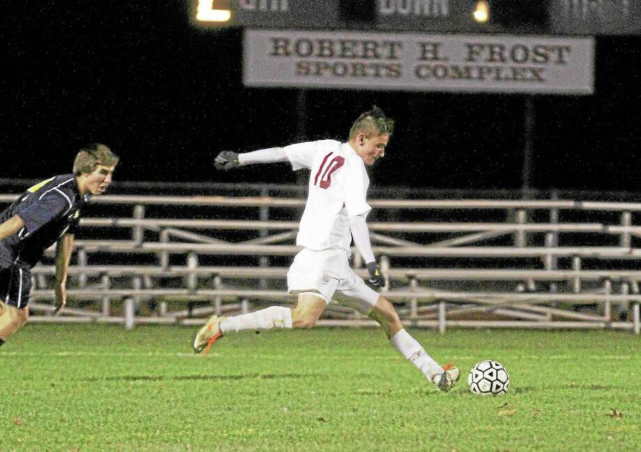 Torrington's Amar Suljic shots and scores the lone goal, with 11 minutes left, in the Red Raiders 1-0 win against Woodstock Academy in the first round of the Class L State Tournament. Photo: Marianne Killackey — Special To The Register Citizen  / 2013