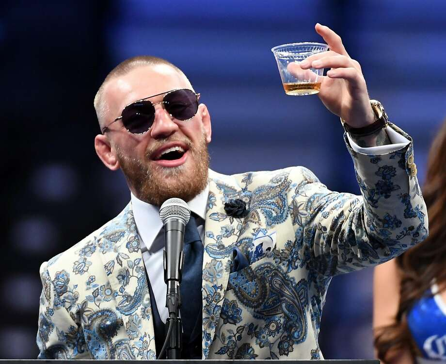 Conor McGregor holds up a whiskey after his loss to Floyd Mayweather Jr., seemingly toasting a bright, money- making future. Photo: Ethan Miller, Getty Images