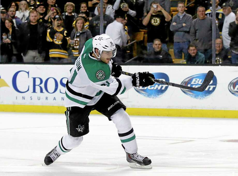 Dallas Stars center Tyler Seguin shoots and scores during the shootout of Tuesday's game against the Bruins in Boston. Photo: Elise Amendola — The Associated Press  / AP