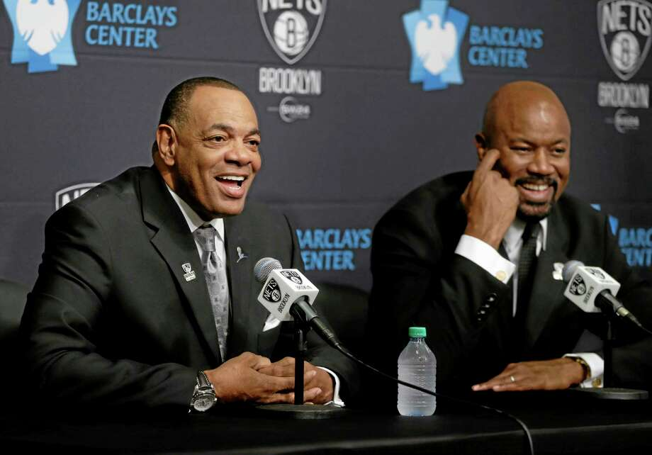 While Brooklyn Nets general manager Billy King, right, listens, Lionel Hollins speaks to the media during a news conference Monday at the Barclays Center in New York. Hollins was introduced as the team's new head coach. Photo: Seth Wenig — The Associated Press  / AP