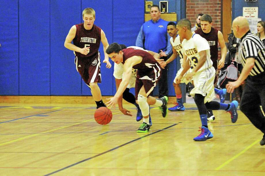 Torrington's John McCarthy look to head down the court during the Red Raiders' game against Gilbert. Photo: Laurie Gaboardi — Register Citizen