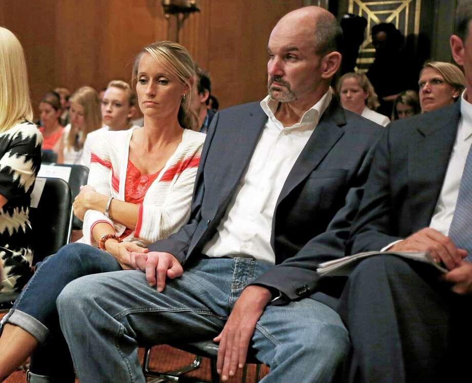 Kevin Turner, right, former NFL fullback who played for eight seasons for the New England Patriots and Philadelphia Eagles, and now suffers from amyotrophic lateral sclerosis (ALS) or Lou Gehrig's disease, listens as former professional athletes Ben Utecht, a Super Bowl-winning tight end for the Indianapolis Colts, and Chris Nowinski, a Harvard football player turned WWE professional wrestler, testify on Capitol Hill in Washington on June 25 before the Senate Special Committee on Aging hearing regarding concussions and the long term effects of brain-related sports injuries. Photo: Charles Dharapak — The Associated Press  / AP
