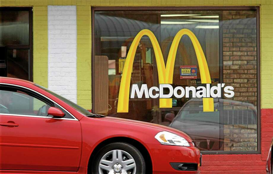 FILE - In this Oct. 17, 2011 file photo, a car moves through a McDonald's drive through window line, in Springfield, Ill. The fast-food giant said in a statement Friday, Oct. 25, 2013, that it is cutting ties with condiment company Heinz after 40 years due to management changes there. A former Burger King CEO became head of Heinz in June after the company was bought by Warren Buffett's Berkshire Hathaway and 3G Capital. 3G, a Brazilian investment firm, also controls Burger King. (AP Photo/Seth Perlman, File) Photo: AP / AP