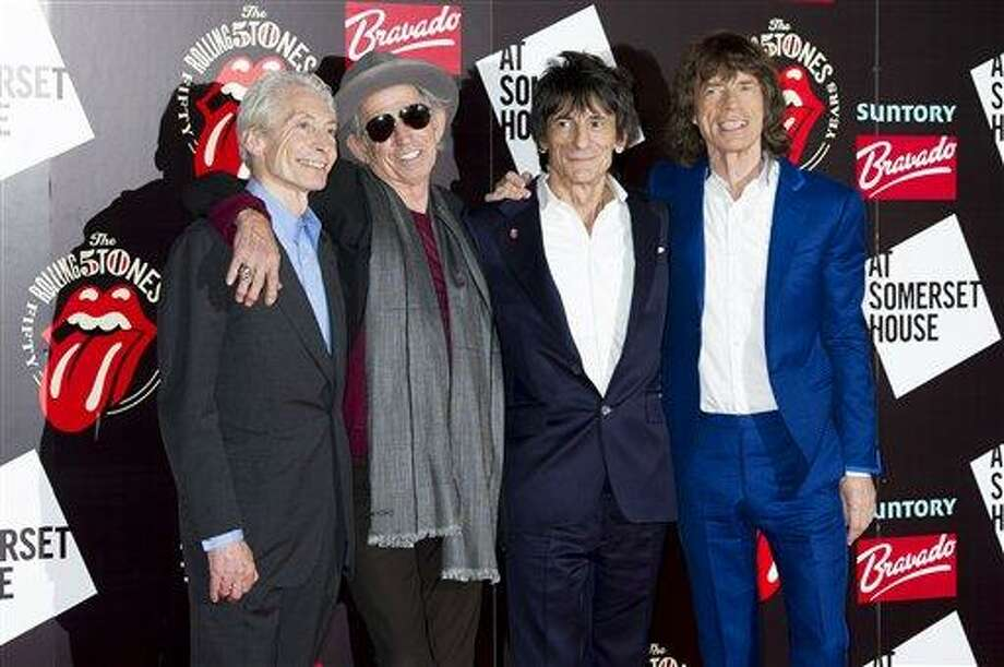 A Thursday, July 12, 2012 photo from files showing, from left, Charlie Watts, Keith Richards, Ronnie Wood and Mick Jagger, from the British Rock band, The Rolling Stones, as they arrive at a central London venue, to mark the 50th anniversary of the Rolling Stones first performance. The Rolling Stones will be taking the stage again this summer at one of Britain's leading music festivals. The Stones' appearance at the 2013 Glastonbury Festival - set to take place from June 28 to June 30 - was revealed Wednesday, March 27, 2013,  in a line-up posted on the festival's website. (AP Photo/Jonathan Short, File) Photo: AP / AP