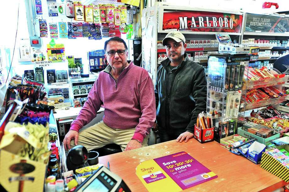 (Peter Casolino ó New Haven Register)   Gerry Katz, left, owner or the Shell Food Mart gas station on Willow Street, shown with employee Dipak Patel. The gas station has been robbed numerous times, but because of security measures police often make arrests.  pcasolino@NewHavenRegister Photo: Journal Register Co.