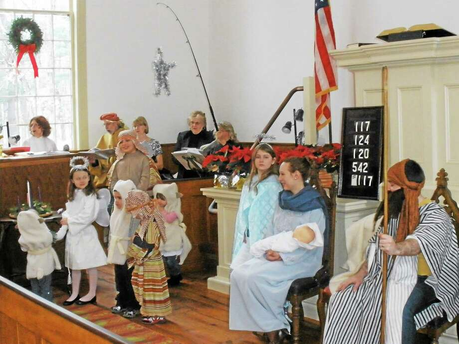 Photos by Stephen Underwood Members of the First Congregational Church in Barkhamsted play various roles in the annual living nativity pageant on Sunday. Playing Gabriel the angel, Mary and Joseph are Molly Davis, 11, Jennifer Wyman-Blackburn and Steven Wyman-Blackburn. Photo: Journal Register Co.