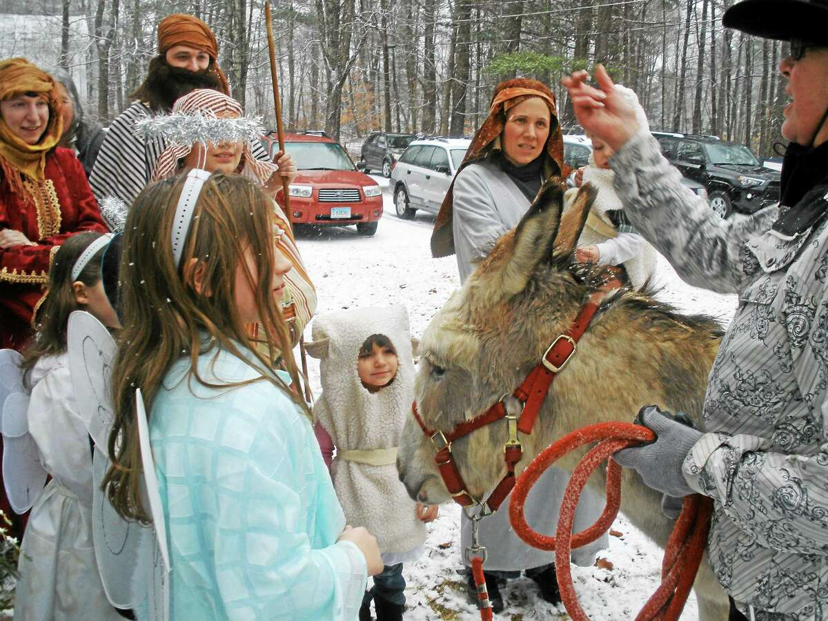Photos by Stephen Underwood Kay Page Greaser's rescued donkey, Patches, was a popular guest at the First Congregational Church's living nativity pageant on Sunday in Barkhamsted.