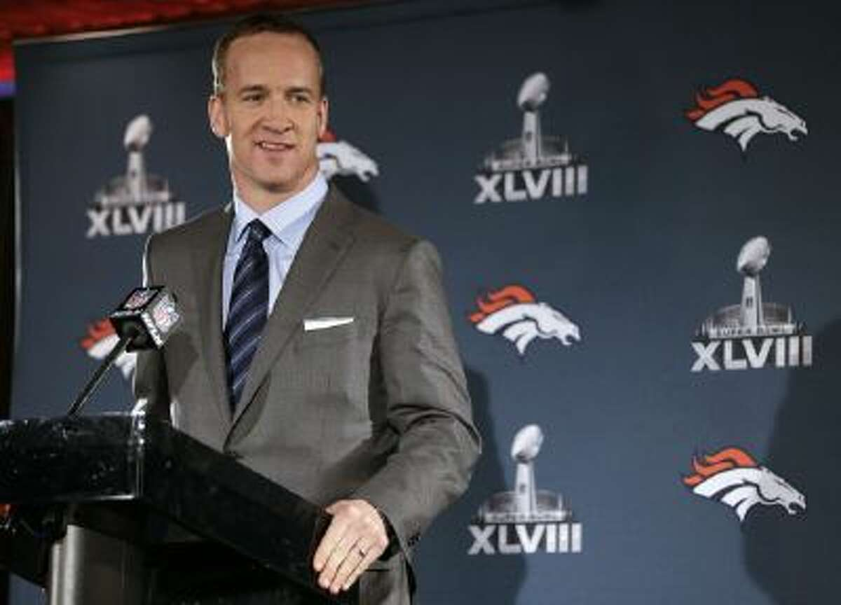 Denver Broncos quarterback Peyton Manning talks with reporters during a news conference Jan. 26, 2014, in Jersey City, N.J.