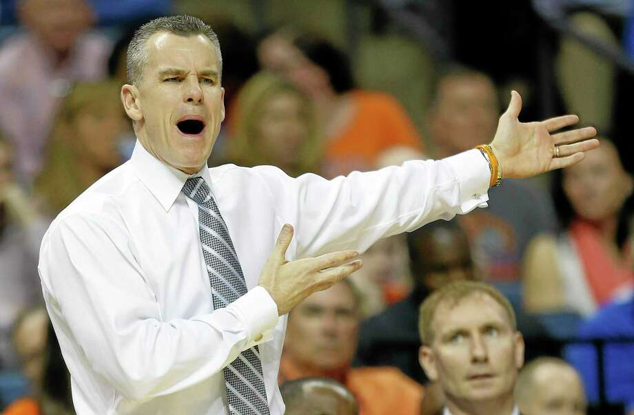 Billy Donovan and Florida will look to avenge one of their two losses this season when they face the Huskies on Saturday. Photo: John Bazemore — The Associated Press  / AP