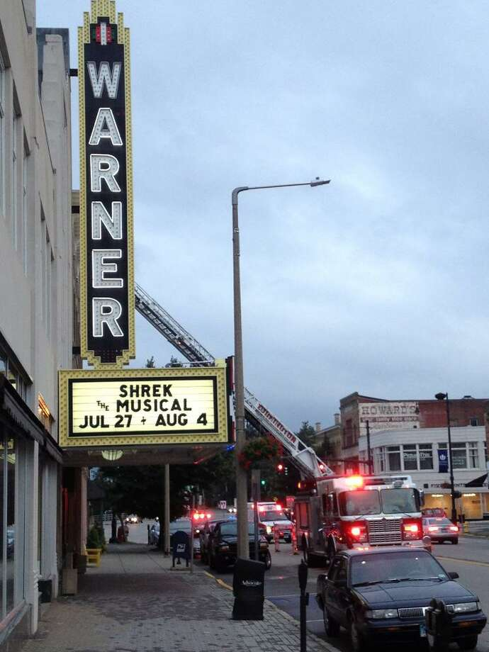 A ladder truck responds to the Torrington's Nutmeg Conservatory on Main St. (Matt DeRienzo-Register Citizen)