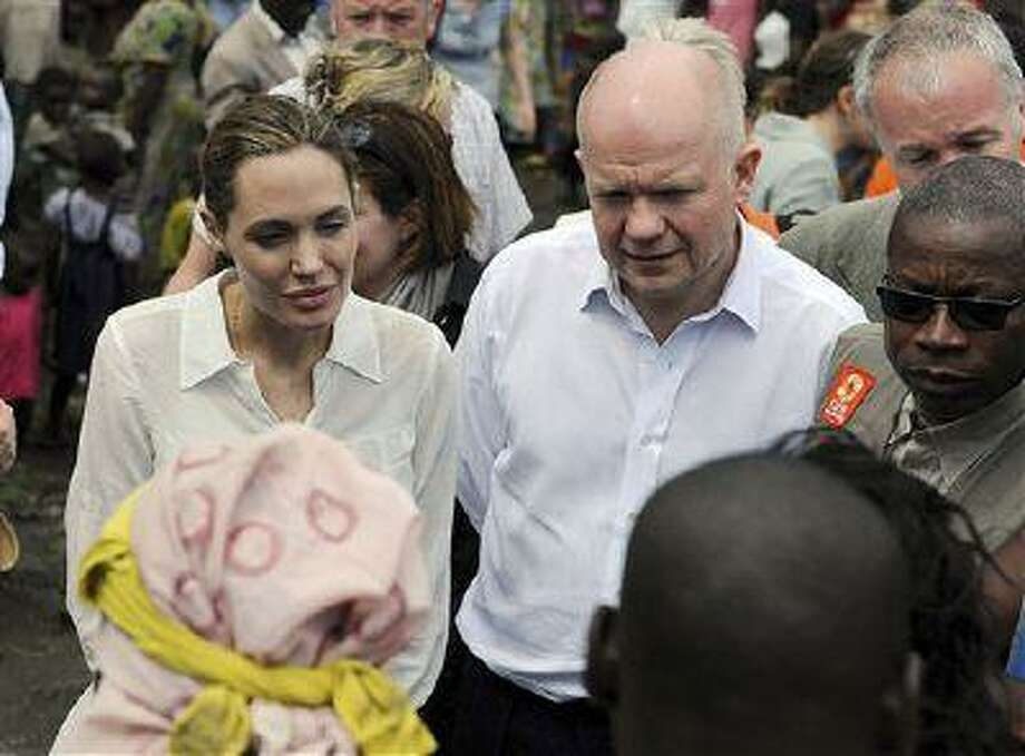 In this image released by Britain's Ministry of Defence Britain's Foreign Secretary William Hague with actress and UNHCR Special Envoy Angelina Jolie visit Lac Vert camp in the Democratic Republic of Congo as they travelled to Africa to to raise awareness of warzone rape Tuesday March 26, 2013. Photo: AP / MOD