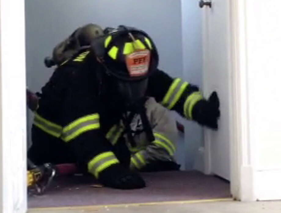A Torrington firefighter participates in a training exercise July 7, 2014. Photo: Screenshot From Video