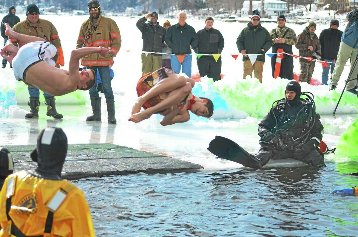 Ninety-two participants jumped in to Highland Lake as part of Winsted's penguin plunge in February as members of local dive rescue teams stood by in case there were problems.