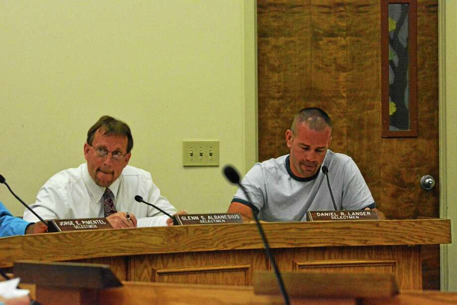 Winchester Selectmen Glenn Albanesius and Robert Langer listen to the details of switching animal control facilities. Photo: Ryan Flynn — The Register Citizen