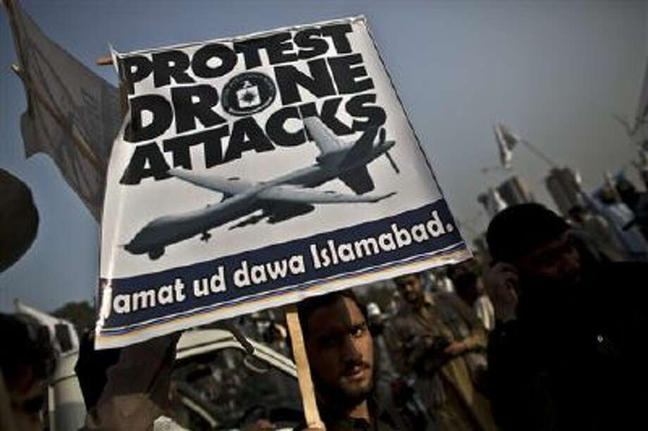 A supporter of the Pakistani religious party Jamaat-u-Dawa holds up a banner during a rally to condemn U.S. drone attacks in Pakistan. Photo: AP / AP