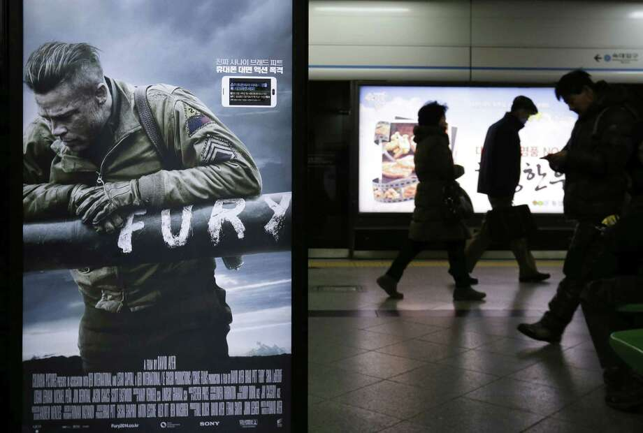 """A poster advertising Sony Pictures movie """"Fury"""" is displayed at a subway station in Seoul, South Korea, Tuesday, Dec. 8, 2014. North Korea released a statement Sunday that clearly relished a cyberattack on Sony Pictures, which is producing an upcoming film that depicts an assassination plot against Pyongyang's supreme leader. (AP Photo/Ahn Young-joon) Photo: AP / AP"""