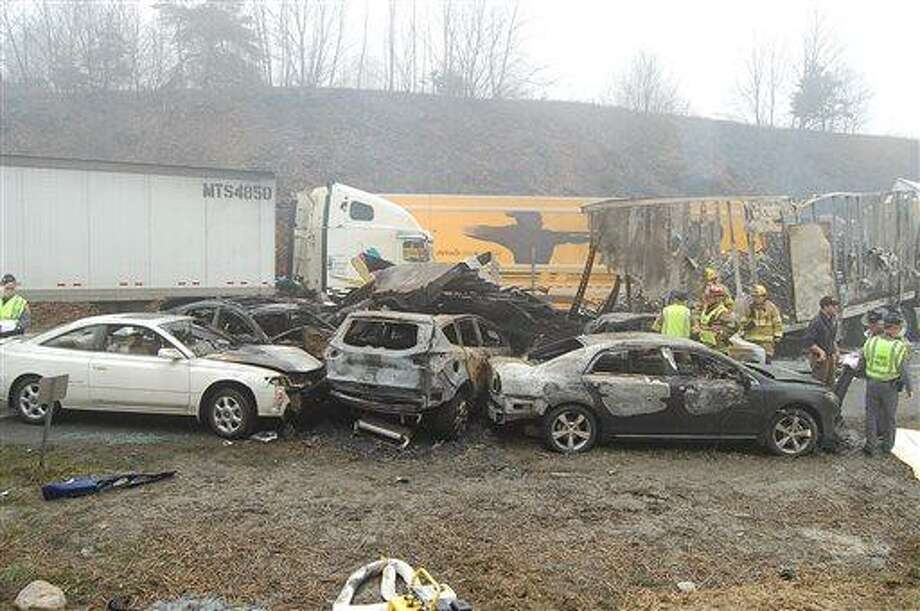 This photo provided by the Virginia State Police shows the scene following a 75-vehicle pileup on Interstate 77 near the Virginia-North Carolina border in Galax, Va., on Sunday, March 31, 2013. Virginia State Police say three people have been killed and more than 20 are injured and traffic is backed up about 8 miles. AP Photo/Virginia State Police, Sgt. Mike Conroy Photo: AP / Virginia State Police