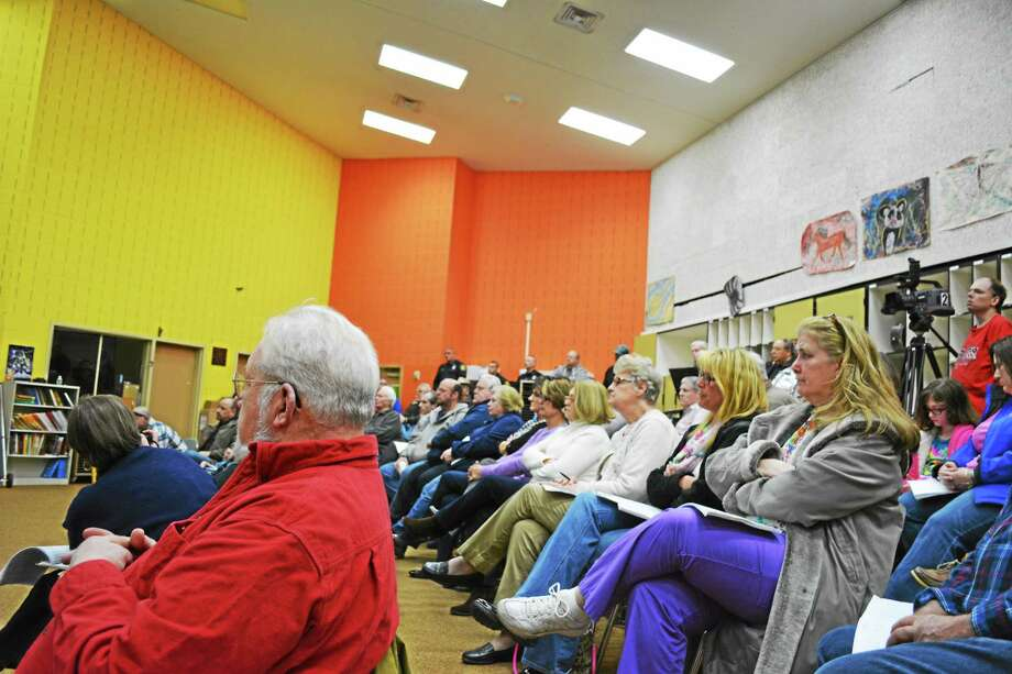 Monday night's public hearing for the 2014-15 town budget was well attended. Residents filled the Pearson School band room. Photo: Ryan Flynn — Register Citizen
