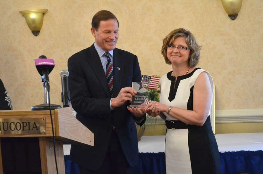 U.S. Sen. Richard Blumenthal (D-Conn.) with new inductee to the Northwest CT Chamber of Commerce, Laurie Roy. JOHN BERRY/REGISTER CITIZEN.