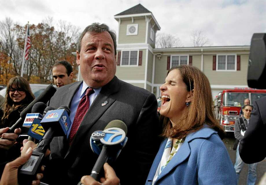 New Jersey first lady, Mary Pat Christie, laughs as husband, Republican New Jersey Gov. Chris Christie, jokes with the media after they voted in Mendham Township, N.J., Tuesday, Nov. 5, 2013. Christie is facing Democratic challenger Barbara Buono in Tuesday's election. (AP Photo/Mel Evans) Photo: AP / AP