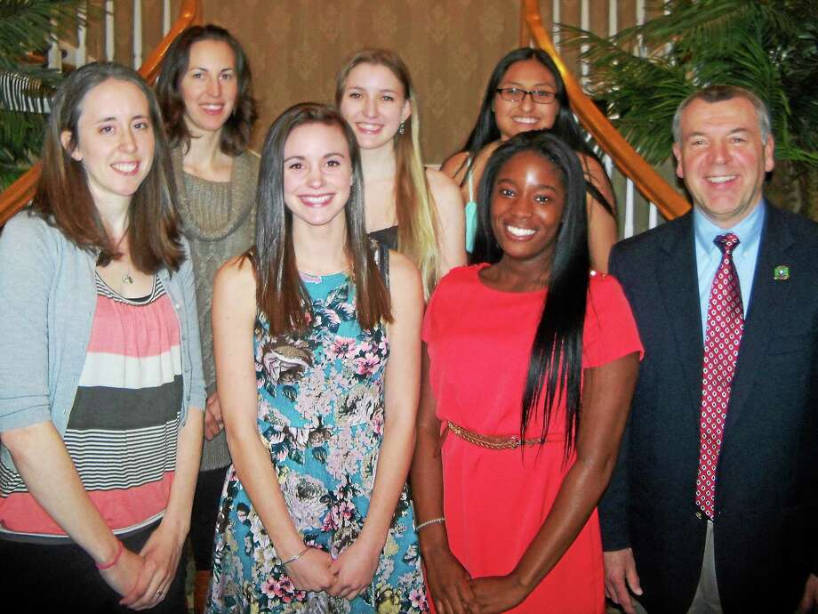Torrington High School's girls basketball team celebrated at the Cornucopia Banquet Facility Sunday evening. Seniors and coaches are, front row from left: freshman coach Barbara Beebe; Olivia Morrison; Mika Howard; head coach Mike Fritch. Second row from left: JV coach Erika Pratt; Caroline Teti; Joann Duman. Photo: Peter Wallace — Register Citizen
