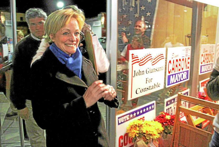 Elinor Carbone, the new Mayor of Torrington, walks into her victory party Tuesday night after results were tallied.Esteban L. Hernandez - Register CItizen Photo: Journal Register Co.