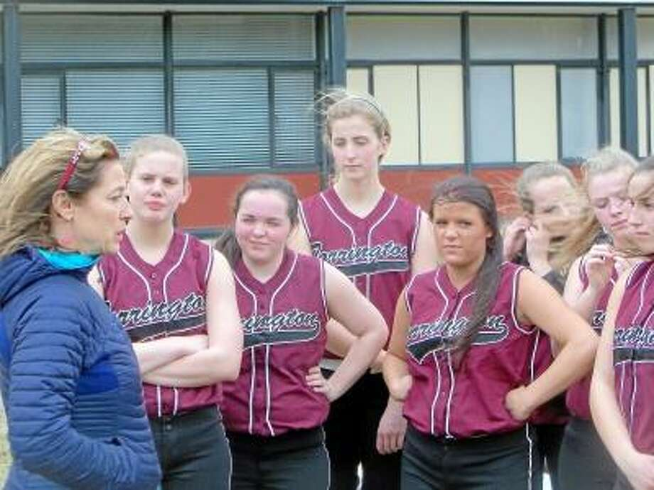 Peter Wallace/Register Citizen  Torrington High School coach Maryann Musselman gathers her varsity players before practice Monday.