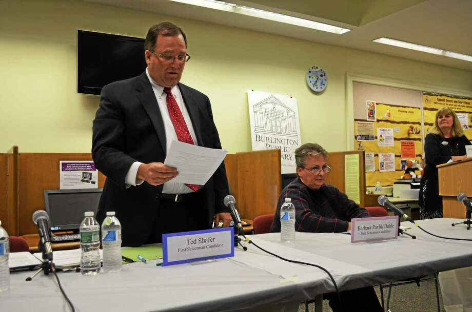 Ted Shafer, standing, will remain Burlington first selectman after defeating Barbara Pavlik Dahle, seen here sitting next to Shafer at a debate in October. Photo: File Photo