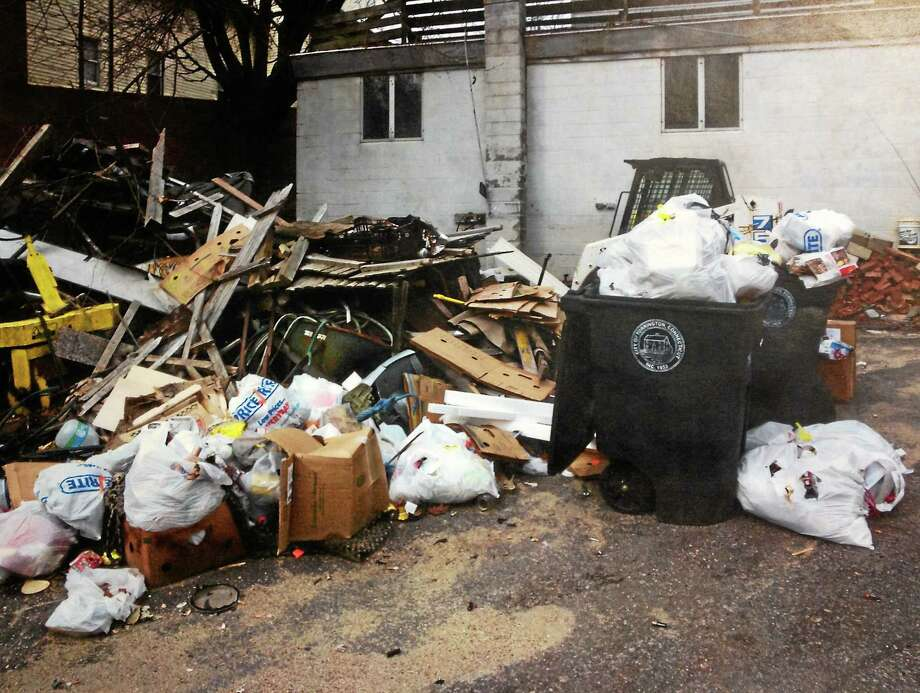 The debris at 408/412 Main St. at the time of a complaint filed in October 2013. Since this photo was taken the property owner has made progress in cleaning up the property and is still working on bringing property to compliance. Photo: Contributed Photo — City Of Torrington