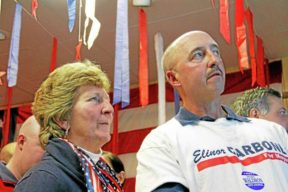 Anne Ruwet, left, and Drake Waldron look on as results from the 2013 municipal election are displayed on a wall inside the Republican party's headquarters on Water Street on Tuesday, Nov. 5, 2013, in Torrington. Both Republicans were elected to serve on the City Council; Waldron was reelected. Photo: Esteban L. Hernandez — Register Citizen