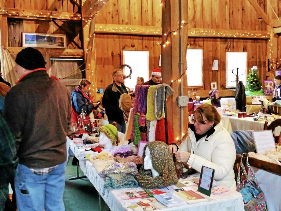 Photos by N.F. Ambery Shoppers peruse vendors' wares at the Goshen Farmers' Market Holiday Finale on Saturday, Dec. 20. Photo: Journal Register Co.