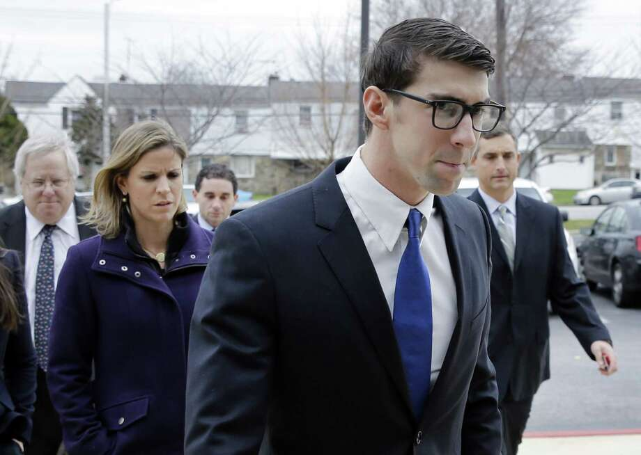 Olympic swimmer Michael Phelps walks into a courthouse for a trial on drunken driving and other charges, Friday in Baltimore. Documents show that the 29-year-old was leaving Baltimore's Horseshoe Casino Sept. 30 when he was pulled over for speeding and crossing the double yellow line on a highway. Police say Phelps registered a .14 per cent on a blood-alcohol test. The legal limit to drive is .08 per cent in Maryland. Photo: Patrick Semansky — The Associated Press  / AP