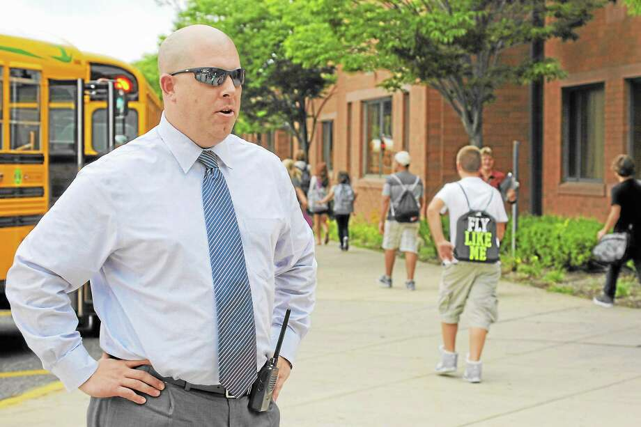 Torrington schools director of secondary education Eric Baim directs Torrington Middle School students to their destination on Thursday, Aug. 29. Photo: Jessica Glenza—Register Citizen