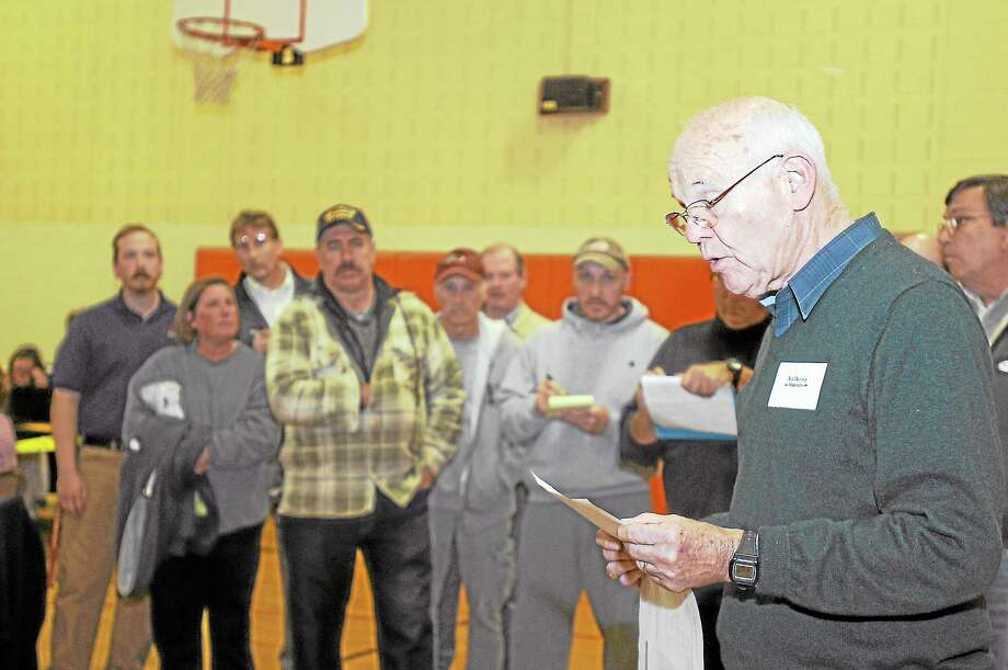 Moderator Neil Kelsey reads the Winchester election results on Tuesday. Photo: Laurie Gaboardi - Register Citizen