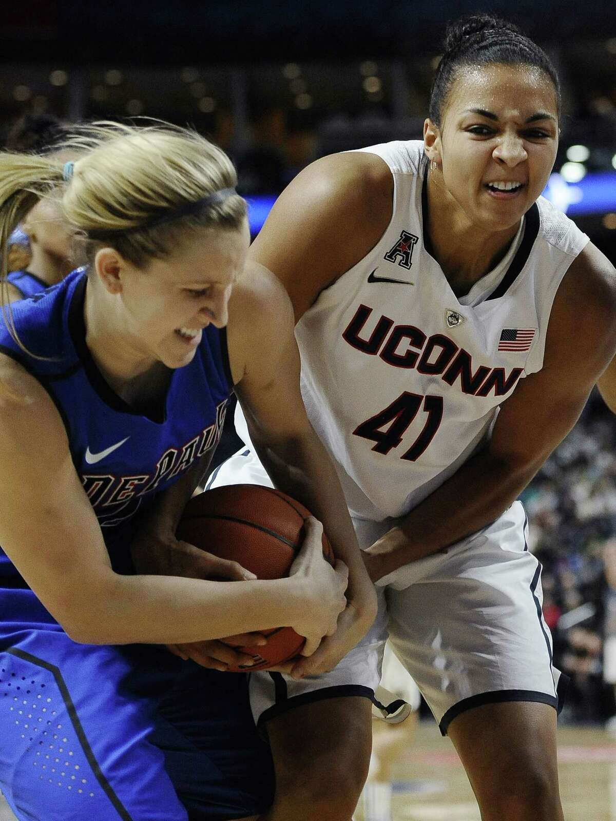 DePaulís Brooke Schulte, left, and Connecticutís Kiah Stokes, fight for control of the ball during the first half of an NCAA college basketball game, Friday, Dec. 19, 2014, in Bridgeport, Conn. (AP Photo/Jessica Hill)
